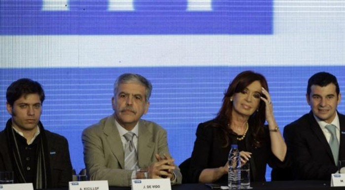 Picture was taken from Urgente24.com.  From left to right is Economy Minister Axel Kicillof, Minister of Public Planning and Investment Julio de Vido, President Cristina Fernandez de Kirchner, and CEO of energy firm YPF Miguel Galuccio.