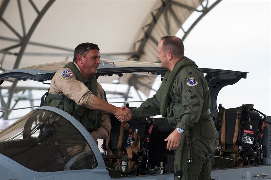 Chris Carlson, left, Sierra Nevada Corporation senior pilot, shakes hands with Lt. Col. Jeffrey Hogan, Afghan A-29 Light Air Support training unit commander, after landing an A-29 Super Tucano for its first arrival Sept. 26, 2014, at Moody Air Force Base, Ga. Moody was selected for the A-29 LAS training mission to train a total of 30 Afghan pilots and 90 Afghan maintainers over the next four years. (U.S. Air Force photo/Airman 1st Class Dillian Bamman) Source: http://www.af.mil/News/Photos/tabid/129/igphoto/2000945466/Default.aspx