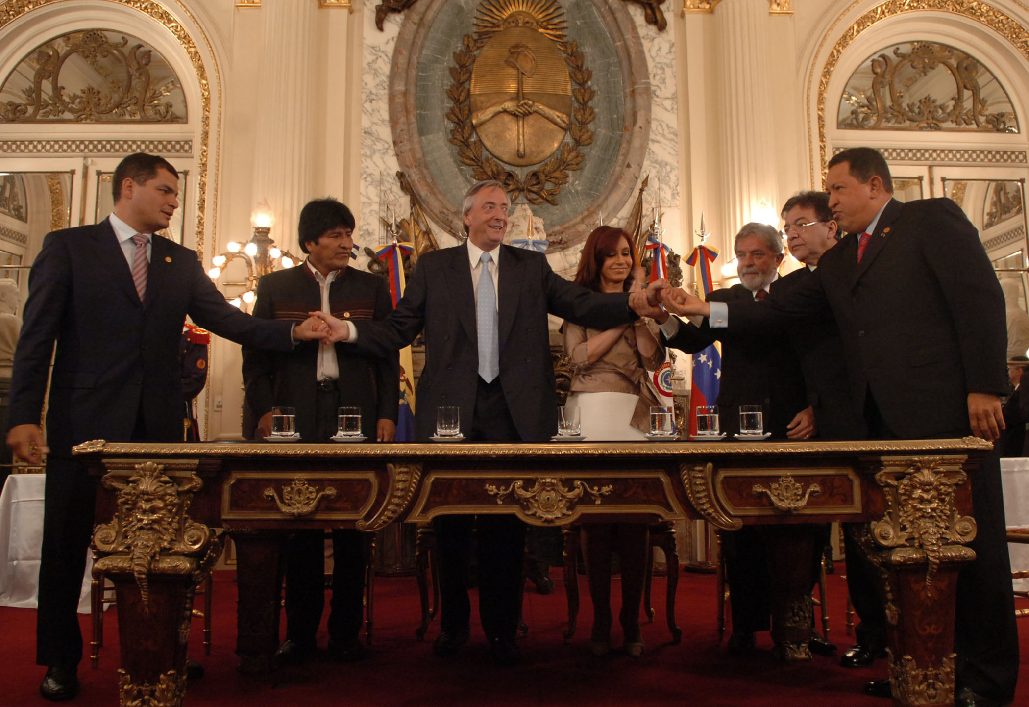 "South American Presidents at the signature of the Charter of the ""Bank of the South"" in 2009. From left to right: President Rafael Correa (Ecuador), President Evo Morales (Bolivia), President Nestor Kirchner (Argentina, 2003-2007), President Cristina Fernandez de Kirchner (2007-2015), President Luiz Inacio Lula da Silva (Brasil, 2003-2011), President Oscar Nicanor Duarte Frutos(Paraguay, 2003-2008) and President Hugo Chavez (Venezuela, 1999-2013)"